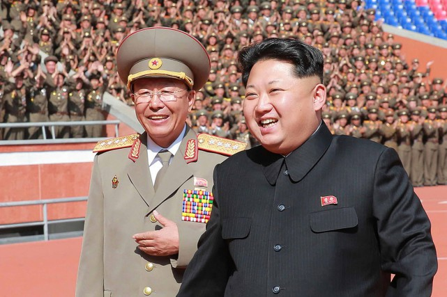 Ri Yong-gil avec le leader nord-coréen Kim Jong-un - Photo AFP