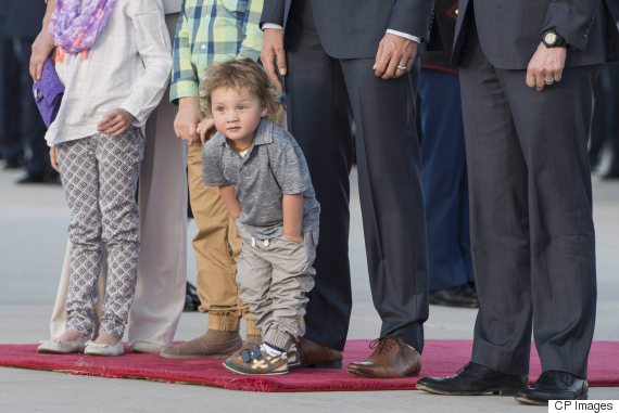 Hadrien Trudeau stands next to his father Prime Minister Justin Trudeau and family members during a welcome ceremony at Andrews Air Force Base, Md., Wednesday, March 9, 2016. THE CANADIAN PRESS/Paul Chiasson