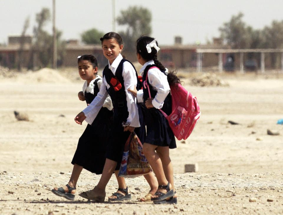 TIKRIT, Iraq:  Iraqi school girls walk home in Tikrit, 170 kms north of Baghdad, 22 September 2005. A joint Iraqi-US military operation to uproot rebels from the northern town of Tal Afar has been successfully completed, the Iraqi operational commander said.   AFP PHOTO/Tauseef MUSTAFA  (Photo credit should read TAUSEEF MUSTAFA/AFP/Getty Images)