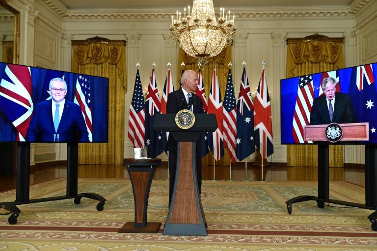 Le président américain Joe Biden annonce une nouvelle alliance stratégique, avec la participation en visioconférence du Premier ministre australien Scott Morrison et du Premier ministre britannique Boris Johnson, le 15 septembre 2021 à la Maison Blanche